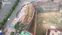 Destroyed road collapses onto a construction site in southern China