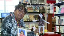 Colombian war victim makes dolls to heal her own pain