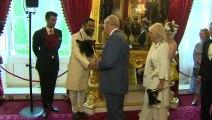 Prince Charles and Camilla don matching masks at Animal Ball