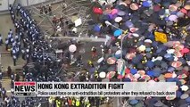 Hong Kong police declare China extradition protest 'a riot' as rubber bullets and tear gas fired at crowd