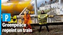 Greenpeace repeint un train transportant des déchets radioactifs