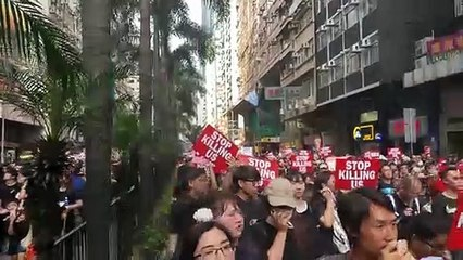 Thousands in black choke Hong Kong's city centre in rally to demand Carrie Law's resignation