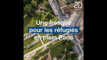 Paris: Une fresque pour les réfugiés aux pieds de la tour Eiffel