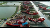 Aerial view of stunning water ways and fishing boats parked during low tide under Dashmile Bridge-4K stock footage