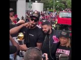 "Kawhi Leonard smoking a cigar and taking pictures with Drake wearing ""Board man Gets Paid"" Shirt at Raptors Championship Parade 6-17-19"