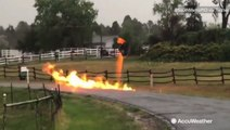 Street sign ignites into raging fire after lightning strikes natural gas line