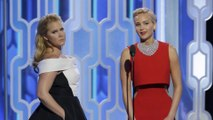 Amy Schumer's baby is coming between her and pal Jennifer Lawrence's texting sessions