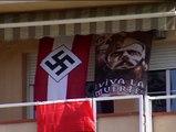 Un vecino de Sabadell exhibe banderas nazis en el balcón de su casa