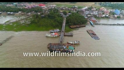 4K birds eye view of the coastline , Kakdwip island, Hooghly river meeting the Bay of Bengal at Gangasagar, West Bengal, India. Stock footage.