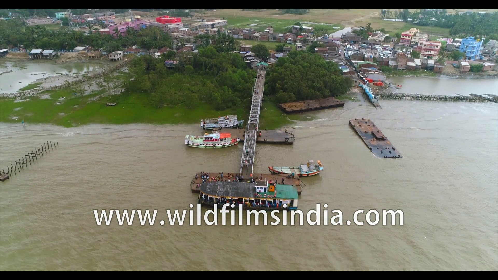 4K birds eye view of the coastline , Kakdwip island, Hooghly river meeting the Bay of Bengal at Gang
