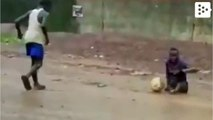Legless kid plays football with shoes on his hands