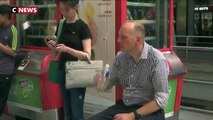Spéciale Canicule: Face à la chaleur écrasante dans les transports en commun, la SNCF et la RATP distribuent de l'eau aux usagers - VIDEO