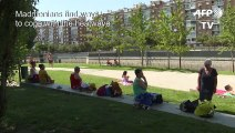 Madrid residents soak up the sun as heatwave hits