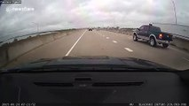 US truck driver 'fails to check blind spot' and slams into highway wall