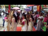 Women perform traditional Kerala dance on the road to protest against potholes