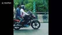 Tail that bike! Monkey spotted enjoying motorcycle ride in India