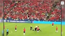 A man with a chicken mask invaded the Chile vs Uruguay stadium