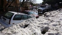 Cars buried as storm drops extreme amounts of hail