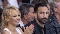 Pamela Anderson's soccer star ex denies abuse allegations