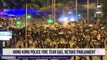 Hong Kong police fire tear gas, retake parliament