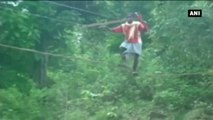 Watch -  Villagers Make Temporary Bridge With Wires To Cross A River