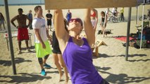 Woman Works Through Beach Obstacle Course