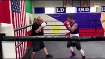 Manny Pacquiao hits the mitts with trainer Freddie Roach at the Wild Card Gym in Hollywood.