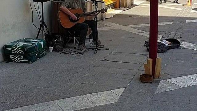 Street Art. Hidden Talent. Very nice guitar player on the streets of Malta