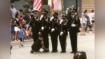 Boy Ties Policeman's Shoe During 4th Of July Parade