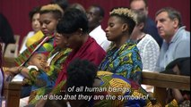 Migrants react after Pope Francis' Mass