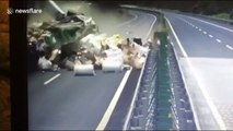 Loaded goods scatter across Chinese motorway after huge truck collision