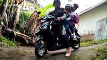 Indonesian motorcyclist fails maneuvering past HUGE millipede and crashes