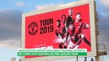 Liverpool fans troll Man Utd training session