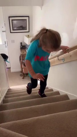 Little Girl with Cerebral Palsy Climbs Stairs for the First Time