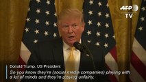 Trump escalates war on social media at White House 'summit'