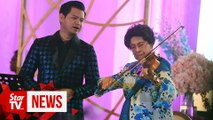 Dr Siti Hasmah serenades crowd with violin