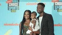 Gabrielle Union, Dwyane Wade, and Kaavia James attend Nickelodeon Kids' Choice Sports Awards