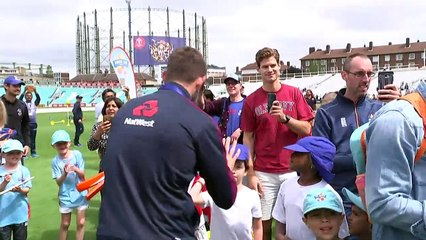 England's cricket team celebrate with fans after victory