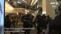 Hong Kong protesters and police clash inside mall