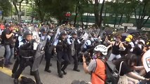 Protesters and police clash in Hong Kong after peaceful march