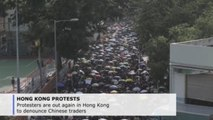 Protesters out again in Hong Kong to denounce Chinese traders