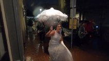 Wedding parade continues as planned even through Barry's rainfall