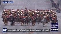 La fanfare du régiment de cavalerie de la Garde républicaine défile sur les Champs-Élysées