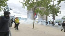 French police fire tear gas as protests follow Bastille Day parade