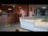 Four Year Old Performs Parkour Jumps off Sofa