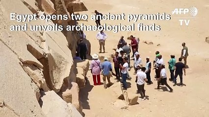 Egypt opens two ancient pyramids, unveils new