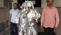 Indian men wearing spacesuits