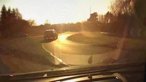 Watch the moment a driver swerves to avoid a car going the wrong way around a roundabout.