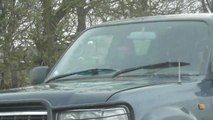 SWNS - Video of frightening moment animal activists were repeatedly RAMMED by a 4x4 while driving to a hunt