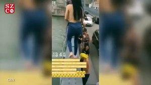 Genç kadın çırılçıplak soyunup köprüden atladı